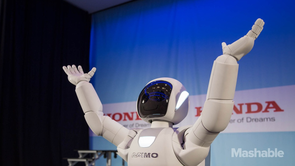 asimo essay robot Visitors watch a honda asimo robot performing at the headquarters of honda  motor co in tokyo canon inc is moving toward fully automating.